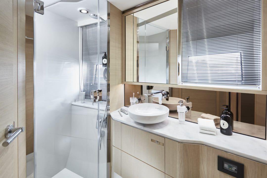 v60-interior-forward-cabin-bathroom-alba-oak-satin